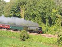 Bulleid unrebuilt 'Battle of Britain' Pacific no 34067 <I>'Tangmere'</I> passing Avoncliff Station on the Bath to Westbury line on 19 August 2012  with 'The Weymouth Seaside Express'.<br><br>[Peter Todd 19/08/2012]