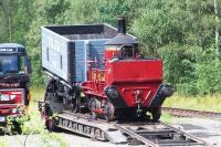 The Head Wrightson Seaham Harbour 0-4-0VBT on a low-loader at Beamish on 22 August 2012, seen from the top deck of a passing tram!<br><br>[Colin Alexander 22/08/2012]