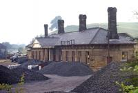The 1862 station at Bakewell, on the one-time MR main line through the Peak District, had closed to passengers in March 1967 and to freight in July 1968. Four years after complete closure, the station forecourt was suffering the ignominy of use as a coal merchant's yard.<br><br>[Bill Jamieson 21/07/1972]