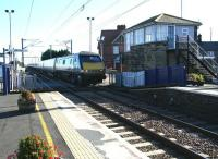 Coming out of the sun, the 09.30 ex-London Kings Cross runs north over Chathill level crossing on 8 October 2012. This train operates non-stop between Alnmouth (13.10) and Waverley (14.15). <br><br>[John Furnevel 08/10/2012]
