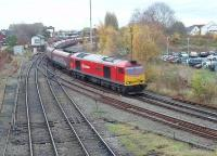 Having just run round its train of empties from Fiddlers Ferry at Latchford Sidings, DBS 60040 runs back through Arpley Junction but turns left for Arpley Yard.<br><br>[Mark Bartlett 13/11/2012]