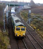 66565 pulls a Saturday morning Freightliner container train towards Birmingham (Hams Hall) away from a signal stop on 8 December - it was held for an Eastbound Turbostar.<br><br>[Ken Strachan 08/12/2012]