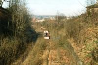 Track lifting operations underway along the former Spen Valley line at Cleckheaton in February 1997, seen looking towards Low Moor. <br><br>[David Pesterfield 14/02/1997]