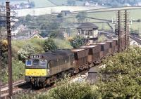The use of a loco of only 1250 HP on the Tunstead to Winnington limestone trains might seem rather surprising, nonetheless the BR Type 2s still managed a twenty year sojourn on these duties. D7659 passes Chinley North Junction with returning empties on the sunny morning of July 17th 1972.<br><br>[Bill Jamieson 17/07/1972]