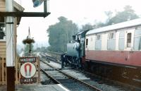 The fireman of small prairie tank 4566 leans out for the token as the train leaves for Bridgnorth in July 1979. <br><br>[Colin Miller /07/1979]