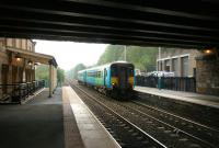 A Sunderland - Hexham train pulls into the westbound platform at Corbridge in May 2006. The impressive main station building, part of which can be seen on the left, has been converted into a restaurant. [See image 9334]  <br><br>[John Furnevel 08/05/2006]