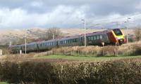 A northbound Voyager catches the sun as it passes through southern Cumbria, close to the former station at Burton and Holme, on 18 February 2012. [See image 22857]<br><br>[John McIntyre 18/02/2012]