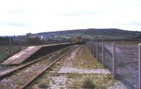 Basic facilities at Colne in August 1977 looking south west towards Nelson. The station was by then a terminus, with the through line to Skipton (behind the camera) having closed in 1970 [see image 38798].<br><br>[Ian Dinmore /08/1977]