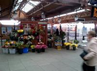 Anyone here called Buster? Even the flower stall at Moor Street is pleasantly old-fashioned. Notice the steam engine to the right of the 'shed'.<br><br>[Ken Strachan 09/11/2012]