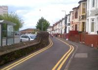 In contrast to Cardiff Road see image [[39471]], here in Ebenezer Terrace, with its brightly colured houses, the narrow bit on the right was the road; and the broad bit on the left was the railway. View looks North and slightly East, towards the River Usk in June 2012; the junction would be perhaps sixty feet behind the photographer. The junction was named after a pub; the standard local salutation being 'Awrightabutt', which might not do as the name of a junction.<br><br>[Ken Strachan 20/06/2012]