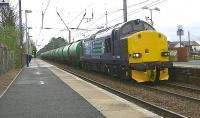 DRS 37606 runs through Barassie on 10 May with the 6R46 Grangemouth - Prestwick Airport tanks. (The locomotive was deputising for failed Colas Rail 66847.)<br><br>[Ken Browne 10/05/2013]