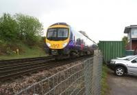 TransPennine 185121 heads west passed Chinley North Junction and signal box with a train to Manchester Airport on a wet and miserable 12 May 2013.<br><br>[John McIntyre 12/05/2013]