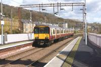 Having just called at Bowling on 27 April, an eastbound service pulls away on the short leg to Kilpatrick.<br><br>[John McIntyre 27/04/2013]