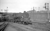 Caprotti standard class 5 no 73154 arriving at Buchanan Street in the Summer of 1965 with train from Dundee.<br><br>[K A Gray //1965]