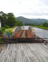 View across the open Banavie rail swing bridge from the adjacent road bridge on 25 June 2013. <br><br>[David Pesterfield 25/06/2013]