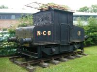 Cosmetically restored Siemens electric shunting locomotive E2 (Works no 455 of 1909), in National Coal Board livery, on a length of track at Beamish Museum in June 2013. No E2 was formerly part of the Harton Coal Company fleet and ended its working life at Westoe Colliery, South Shields, in the 1980s. [See image 18190]<br><br>[Veronica Clibbery 11/06/2013]