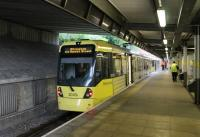 A pair of Metrolink 3000 series trams waits briefly in the Bury terminus before returning to Altrincham via Manchester. The station was opened in 1980 and served by the Bury electric trains for twelve years. [See image 40984] for the scene before conversion to tram operations. <br><br>[Mark Bartlett 31/07/2013]