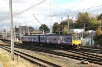 Crossing from the Barrow line platform to the Up Main line as it leaves Carnforth is Northern 150145. The train is the daily Leeds to Heysham Port service, which will reverse at Lancaster and Morecambe before connecting with the Douglas sailing. <br><br>[Mark Bartlett 25/10/2013]