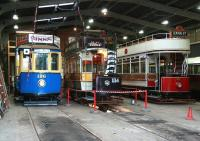 Vintage tram lineup in the depot at Beamish in November 2013. No 196 is originally from Portugal, built to a pre-First World War design and is now painted in Gateshead livery. Newcastle 114 was built in 1901 for the opening of Newcastle Corporation Tramway. Blackpool no 31 also dates from 1901 and was in service in Blackpool until 1984.<br><br>[John Furnevel 07/11/2013]