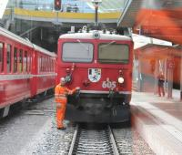 Manoeuvres at Chur, the junction where the eastbound <I>Glacier Express</I> is divided into two portions for Davos and St Moritz.  This was taken through the corridor connection of the Davos portion as it was shunted towards Rhaetian Ge 4/4 1 loco 605 <I>Silvretta</I>. This venerable machine, dating from 1953, is one of only four survivors of a class of 10 1588hp locos.  <br><br>[Mark Bartlett 14/09/2013]