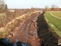 Waverley trackbed looking north from an unclassified road just west of the A7 at Arniston, between Newtongrange and Gorebridge, on 29 November 2013. The headgear of Lady Victoria Colliery is visible top right. <br><br>[John Furnevel 29/11/2013]