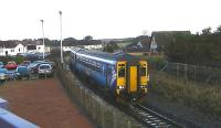 Scotrail DMU 156512 on 2A05 Kilmarnock to Girvan passing the abandoned branch platform at Barassie on 23 January 2014. Housing now covers much of the land once occupied by the former Barassie railway wagon works.<br><br>[Ken Browne 23/01/2014]