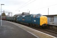 Not an everyday sight at Carnforth. Deltic 55002 <I>The Kings Own Yorkshire Light Infantry</I> arrives on 1 February 2014, returning two coaches that had been borrowed for the move of <I>Duchess of Hamilton</I> from Shildon to York earlier in the week.<br><br>[John McIntyre 01/02/2014]