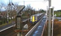 ScotRail EMU 380014 on the 12.14 Glasgow Central to Ayr service passes through Barassie on 23 January 2014.<br><br>[Ken Browne 23/01/2014]