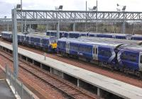 Class 334s in the sidings on the south side of Bathgate station on 22 February. <br><br>[Bill Roberton 22/02/2014]
