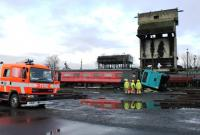 A Lancashire Emergency Services exercise took place at Carnforth on 1st March 2014 using some coaching stock in sidings at the old steam shed, now owned by West Coast Railways. Here a Lancashire fire crew deal with the incident in front of the old coaling tower.   <br><br>[Mark Bartlett 01/03/2014]