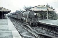 S15 4-6-0 no 30823 runs through Basingstoke station on 24 August 1964 with empty mineral wagons.<br><br>[John Robin 24/08/1964]