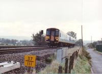 1988 - when men were men... and 155308 was factory fresh. The DMU is heading North from Newport towards Cwmbran, past the site of Ponthir station. That yellow number in the foreground would be a milepost, not a TOPS number.<br><br>[Ken Strachan /09/1988]