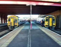Northern 158s meet at Bradford Interchange on the morning of 24 March. Unit 1588755, on the right, is heading for York while 158753 is on a Calder Valley service to Manchester Victoria. <br><br>[Mark Bartlett 24/03/2014]