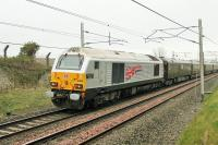 Silver liveried 67026 <I>Diamond Jubilee</I> brings up the rear on the Royal Train passing Carnforth on 9 April 2014 conveying HRH The Prince of Wales to Oxenholme.<br><br>[Mark Bartlett 09/04/2014]