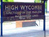 Amazing what you find when you take down a few old posters. Seriously outdated station sign at High Wycombe in April 2014. The connections to Marlow and Maidenhead were severed some 44 years ago.<br><br>[Ken Strachan 26/04/2014]