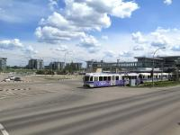 Southern terminus (and a transport interchange) of the 21km Edmonton LRT system is Century Park. This half barrier crossing just outside the station is one of many in the area crossing major and minor roads alike. With a frequent service of articulated trains on the LRT the barriers are often down against motorists and pedestrians but only for short periods. <br><br>[Malcolm Chattwood 13/06/2014]