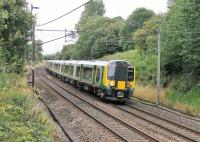 The extra Commonwealth Games traffic has seen Trans Pennine EMUs supplemented by London Midland sets. 350373 is seen here heading south at Barton and Broughton on a Glasgow to Manchester Airport service on 30th July in tandem with TPE 350404.  <br><br>[Mark Bartlett 30/07/2014]