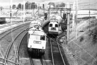An electrically hauled up express passing a pair of EE Type 1s assisting another electric locomotive on an up train standing in the loop at Abington in 1980. [See image 23276]<br><br>[Colin Miller //1980]