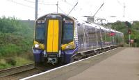 The 1218 Glasgow Central - Ardrossan Harbour formed by Scotrail EMU 380108 calls at Ardrossan South Beach on 13 August 2014.<br><br>[Ken Browne 13/08/2014]