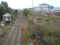View east from Belasis Avenue overbridge along the line to Port Clarence on 15 October 2014. The operational Belasis Lane signal box controls the end of the twin track section from the junction with the main line south of Billingham station and access to the disused sidings to the right, serving the Haverton Hill chemical complex. [Security staff then arrived to question me as to what I was photographing, as it is seemingly forbidden to take views of the chemical plant.] <br><br>[David Pesterfield 15/10/2014]