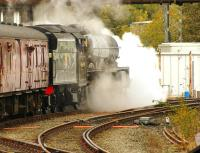 Preserved Jubilee 4-6-0 no 45690 <I>Leander</I> takes the Hellifield line as it sets off past Carnforth Station Junction signal box on 16 October 2014 during a test run.<br><br>[John McIntyre 16/10/2014]