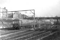 A North Clyde electric multiple unit passing Bellgrove Junction westbound on 15 November 1960 with an Airdrie to Dalmuir Park service.  <br><br>[G H Robin collection by courtesy of the Mitchell Library, Glasgow 15/11/1960]