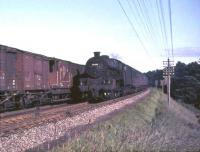 Trains meet on the WCML near Braidwood, South Lanarkshire, on 16 July 1965. Jubilee 45698 <I>Mars</I>, heading towards Glasgow with a train from Manchester, passes an unidentified up freight.    <br><br>[John Robin 16/07/1965]