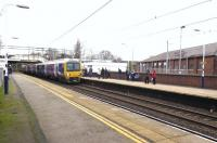 In a path between frequent Virgin and CrossCountry expresses and with its destination blind showing its starting point, Northern Rail 323238 arrives at Congleton with a Stoke-on-Trent to Manchester stopping service on 22 December.<br><br>[Malcolm Chattwood 22/12/2014]