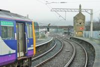 A Leeds service departs from Carnforth on 3rd January. 144015 has just squealed round the check rail in the station and will now squeal round the Wennington line curve. In the background scaffolding surrounds the signal box, which is still operational but scheduled to close in 2021.<br><br>[Mark Bartlett 03/01/2015]