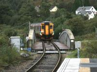Train for Mallaig crossing the Caledonian Canal at Banavie in September 2005.<br><br>[John Furnevel 28/09/2005]