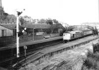 BRCW Type 2 26029 with a southbound service at Broughty Ferry in August 1982. The train is standing alongside the abandoned bay platform at the west end of the station.<br><br>[John Furnevel 25/08/1982]