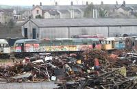 47776 stands among the scrap and other stored locos in the component recovery area at the West Coast Railways Carnforth Depot on 5 January 2015. The RES Brush 4, which has been here since 2007, is flanked by 47368 and 47526 with operational shunter 08418 just visible behind.<br><br>[Mark Bartlett 05/01/2015]