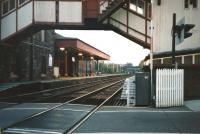 Looking south through Broughty Ferry station in October 1997. Photograph taken from the level crossing through the arch of the unique signal box / footbridge. [See image 2916]<br> <br><br>[David Panton 23/10/1997]