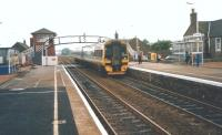 An Aberdeen-bound 158 arrives at Carnoustie in July 1998.<br> <br><br>[David Panton 17/07/1998]